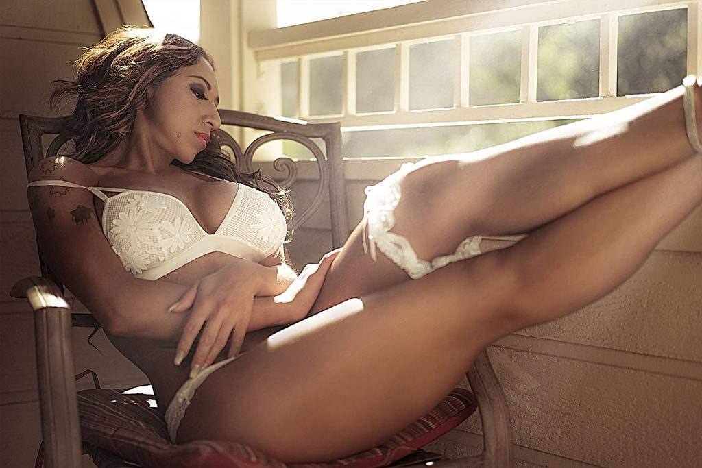 Boudoir-model-in-white-lingerie-sitting-on-the-porch