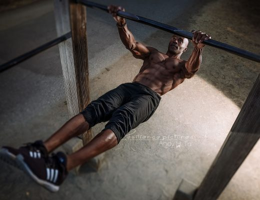Calisthenics athlete, doing a front lever