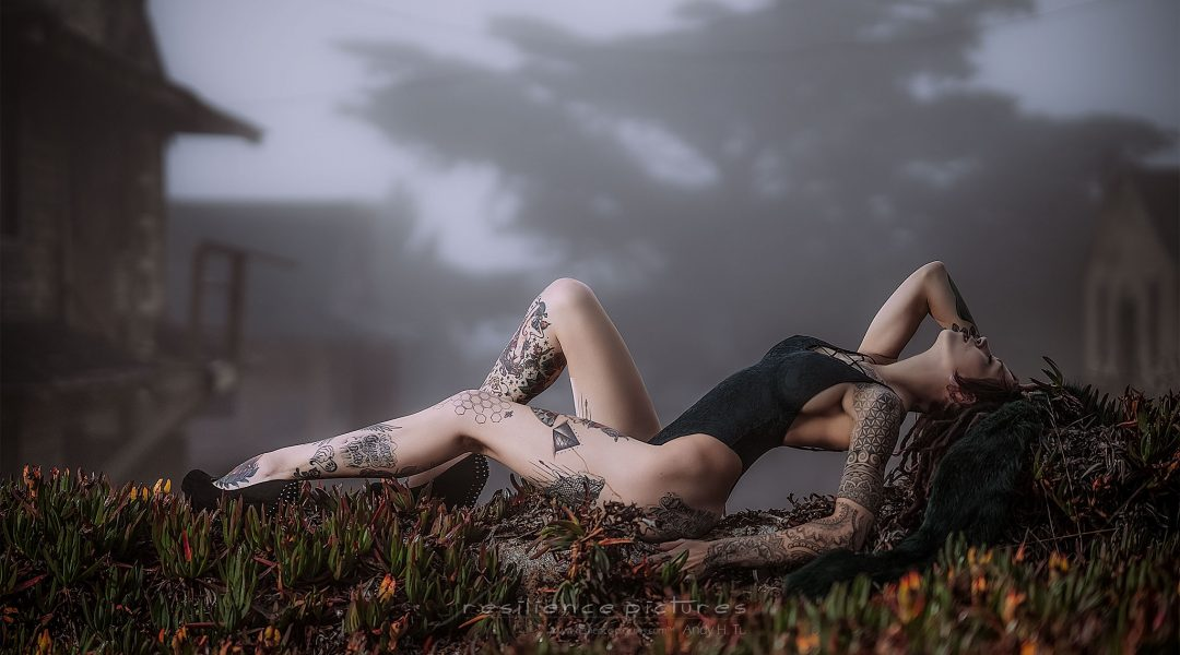 Pale tattoo girl laying in ghost town