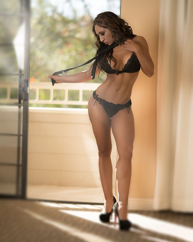 curvaciously fit model in black lingerie and tie