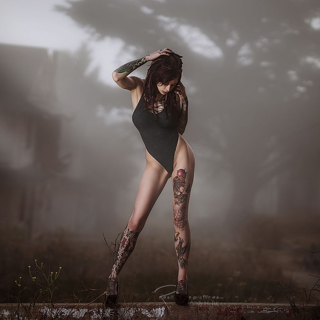 tattoo model posing on a ledge of ghost town