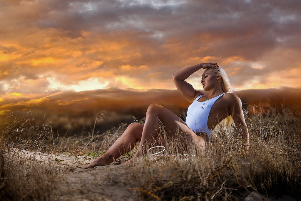 early in the morning white bikini blonde under orange cloudy sky
