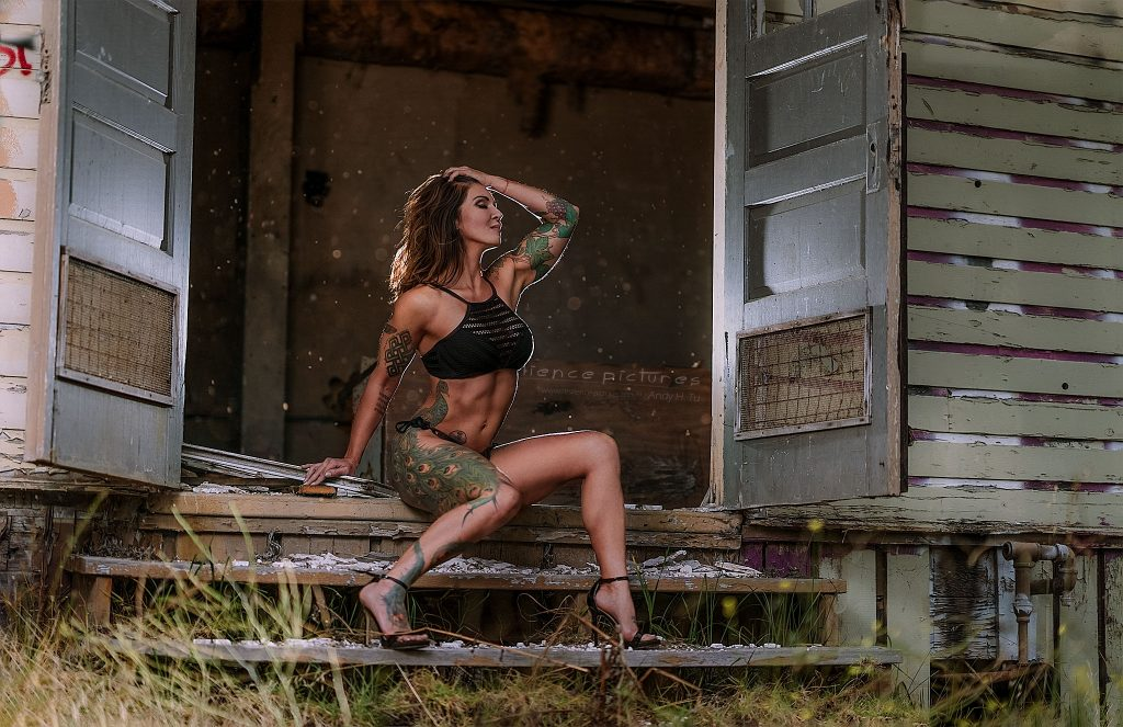 Peacock tattoo boudoir model in abandoned building
