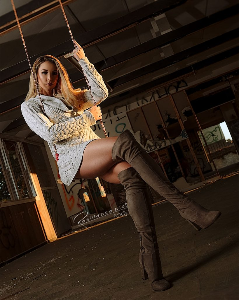 Girl on an indoor swing with boots