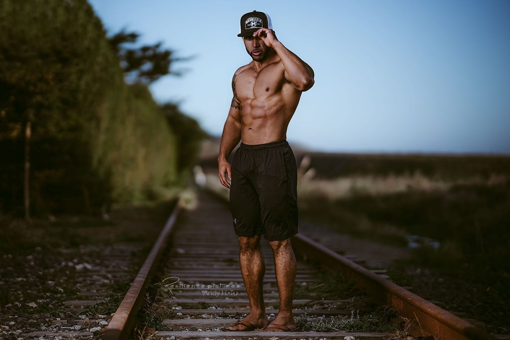 Max Muscle athlete on train track