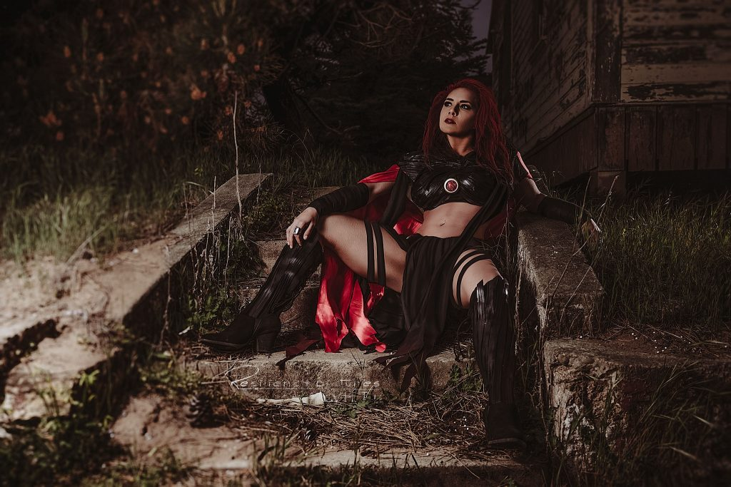 Tawni the fit sorceress sitting on stone steps