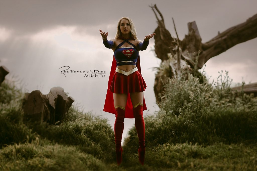 Supergirl levitating and reaching out