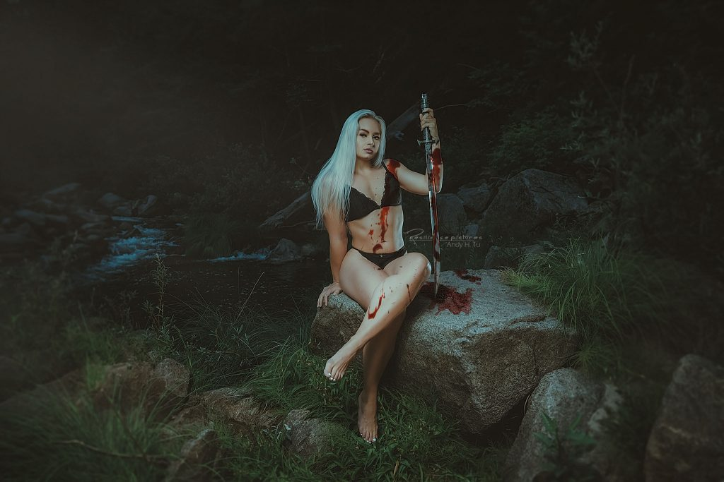 swedish girl and her sword covered in blood in eden