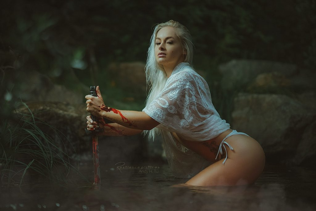 blonde girl with a bloody sword in the hotspring