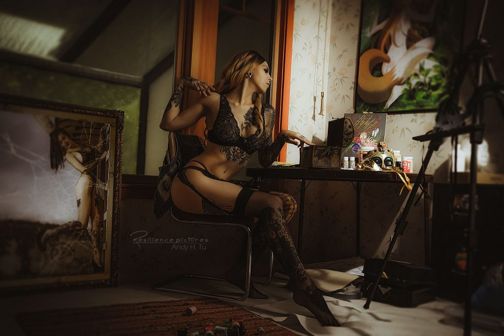 tattoo lingerie model in a crafts room
