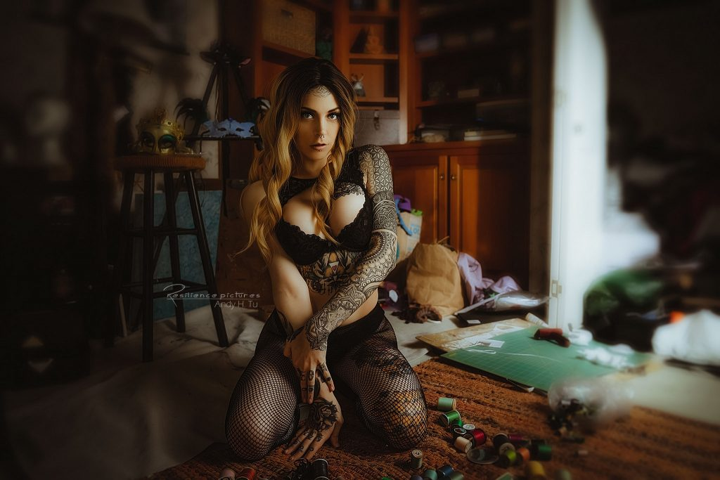 tattoo lingerie model in a messy crafts room
