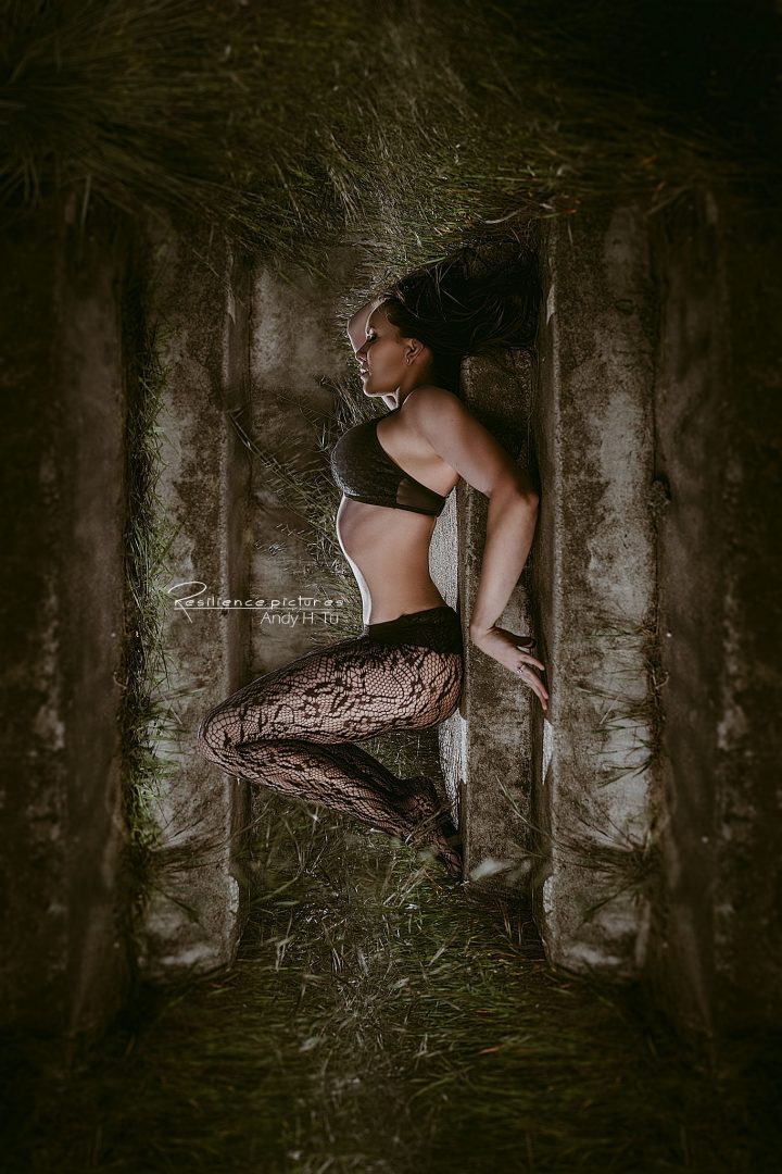 Sleeping Beauty Boudoir Model in Black Laced Stockings and lingerie on stone steps.