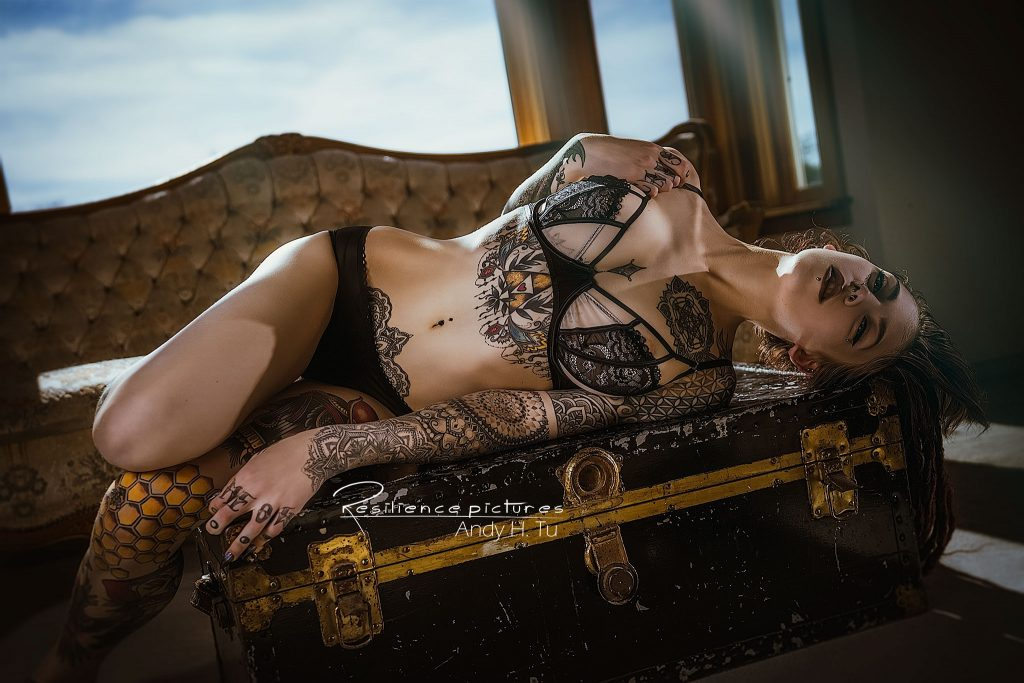 Tattoo model on an old treasure chest