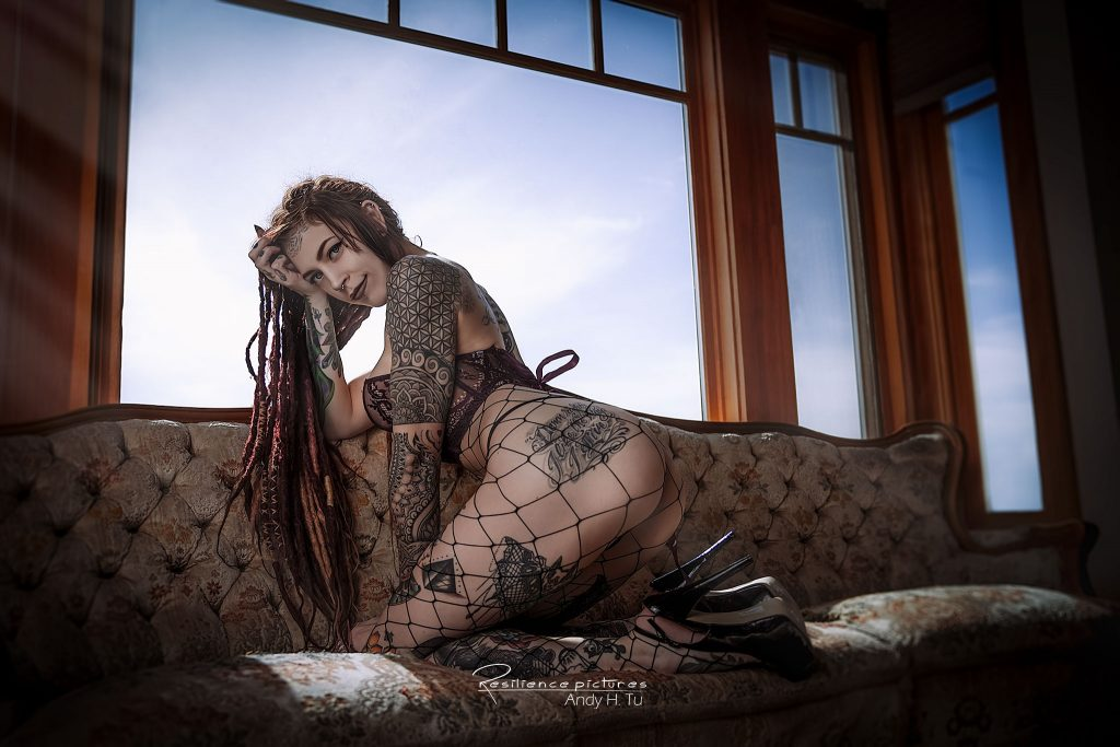 Tattoo model with dreads in fishnet lingerie Smiling