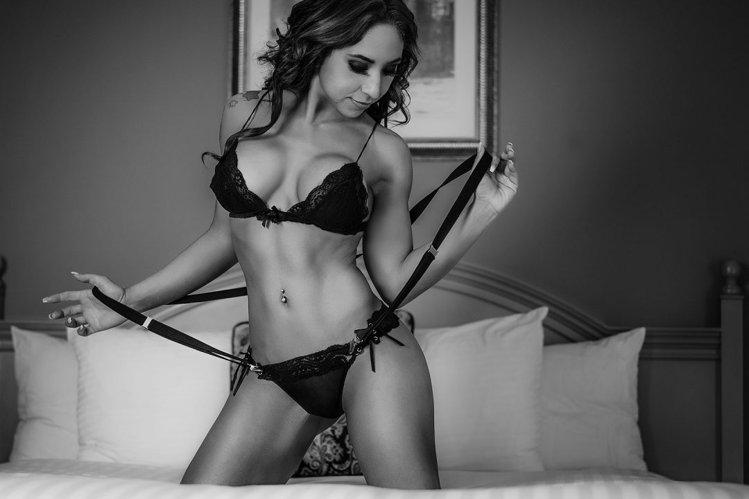 black-and-white-latina-boudoir-photo-in-lingerie-suspenders