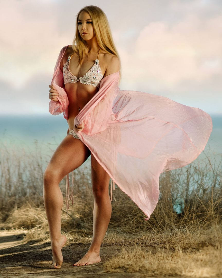 blonde-model-in-pink-flowing-swimwear-at-the-beach